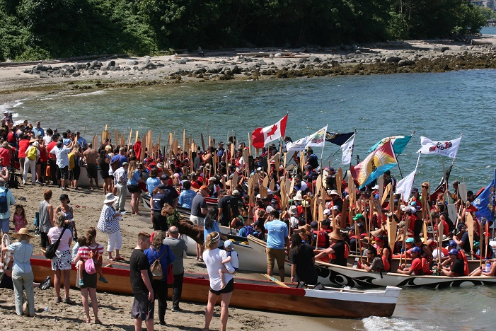 The scene on the beach at the Gathering of Canoes