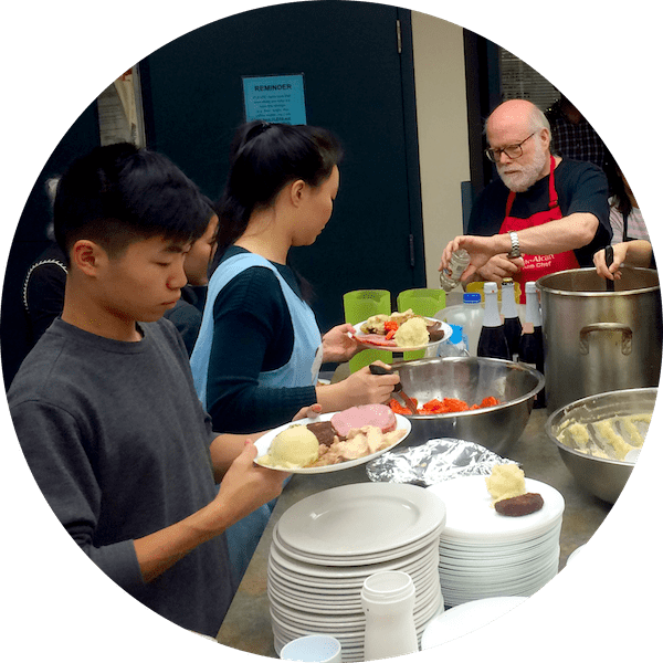 Three people in the CNH kitchen preparing food