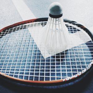 a shuttlecock on top of the badminton racket